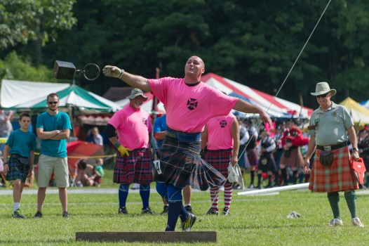 Athlete Eric Frasure competes in the hammer throw at the 2014 Grandfather Mountain Highland Games. Photo by Skip Sickler.