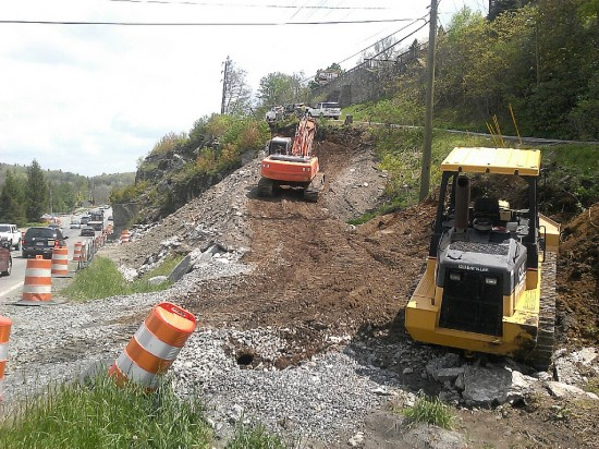Ramp construction has resumed below Cliff Dwellers Inn on U.S. 321 in Blowing Rock in preparation for drilling/blasting operations scheduled to resume on May 30, weather permitting.